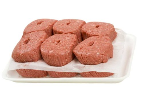 - extra lean ground beef patties in container; isolated on white background